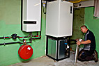 Vvs-montør - Heating and sanitary technician testing and adjusting a geothermal heating boiler