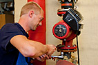 Vvs-montør - Heating and sanitary technician installing a new circulating pump
