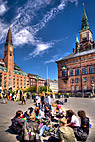 Rådhuspladsen i København - Group of young people sitting at Copenhagen town hall square